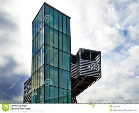 modern architecture green glass elevator stock image