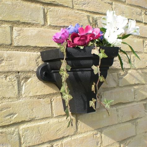 Cast Iron Wall Planter by Cast Iron Style Wall Planters Drainage Central
