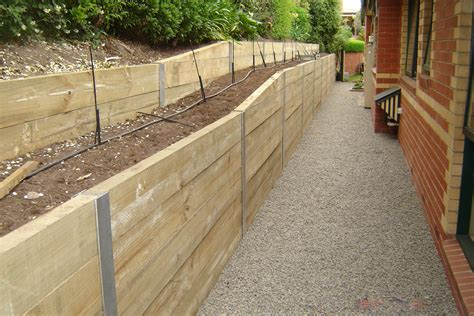 Pine Sleepers Retaining Wall by Retaining Walls Melbourne Cm Landscaping