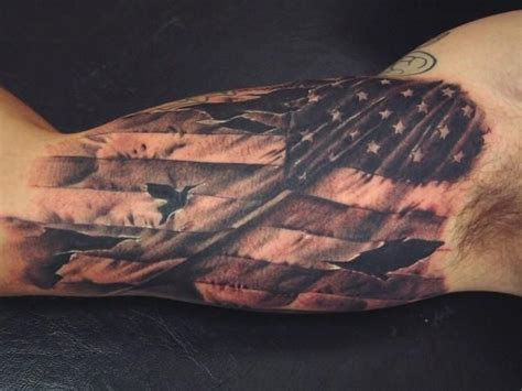 ripped flag tattoo american flag inner bicep tattoos