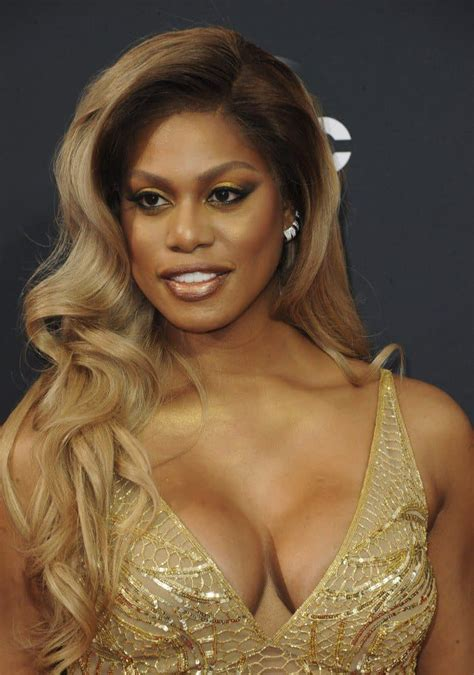 laverne cox laverne cox shimmers in custom gold naeem khan gown