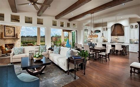 great room definition a fireplace and rustic beams define this inviting space the shenandoah plan built by