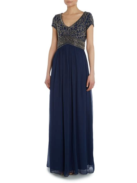 Adiana Navy papell empire waist gown with beaded top in blue