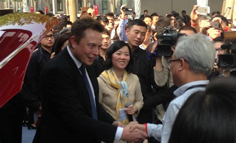 elon musk china tesla delivers its first electric cars in china delays