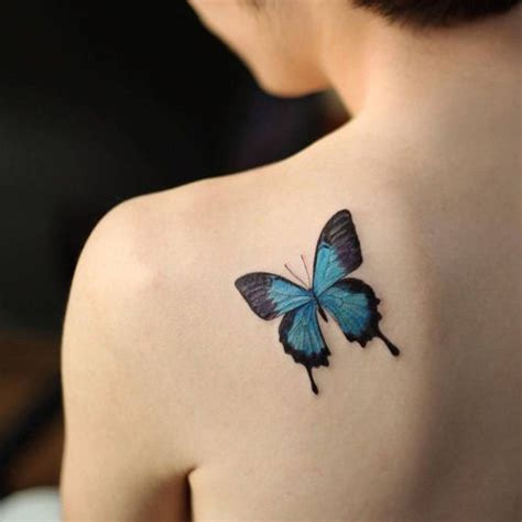 small blue butterfly on the left shoulder blade