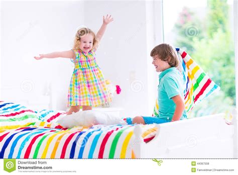 little girls flashing children kids having pillow fight stock photo cartoondealer com