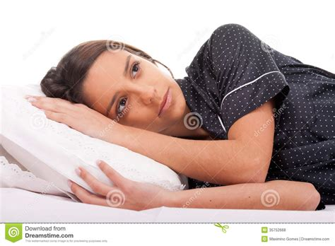 woman lying in bed with my eyes open royalty free stock