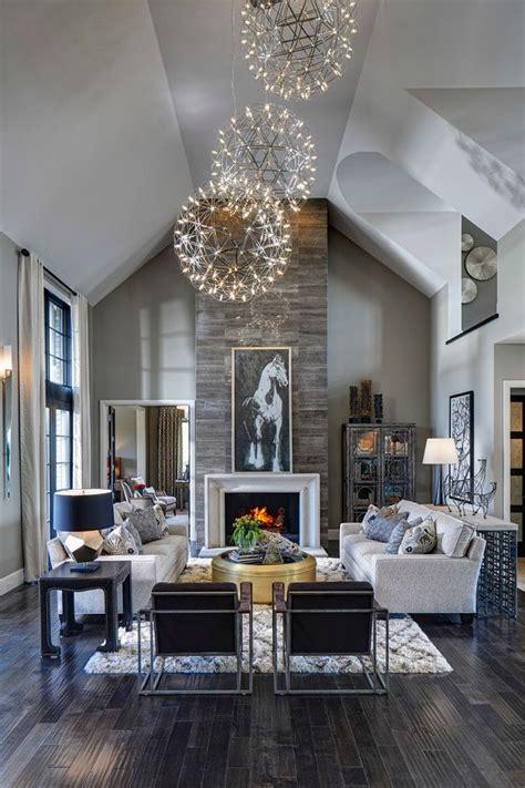 dark bedroom black walls chandelier fireplace purple living room great room dark rustic wood floors stone