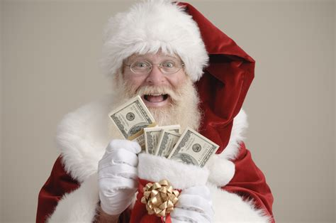 images of christmas money one in 10 still paying off 2013 christmas debt the money