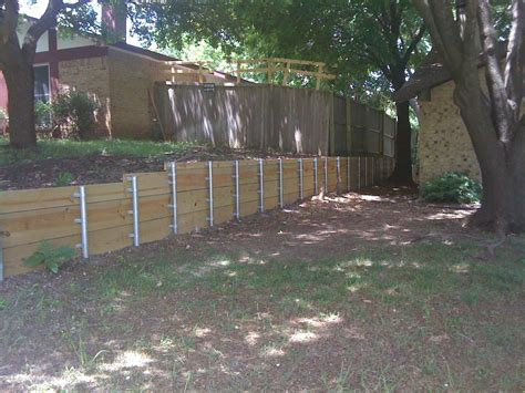 wood retaining wall with steel post yelp