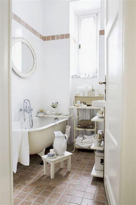 simple small bathroom  white tub white wall tiles