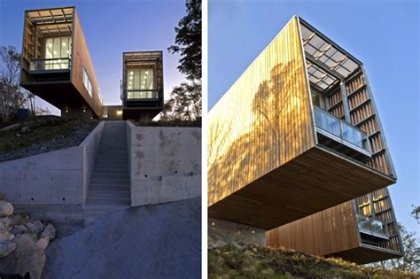 cantilevered two hull house heated by the earth peers over coastal nova scotia two hulls house