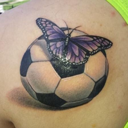 soccer ball tattoo butterfly on soccer by bradley pearce tattoonow
