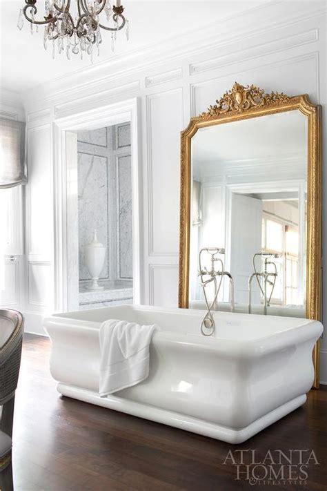 bathtub mirror freestanding tub in front of gold leaf baroque mirror