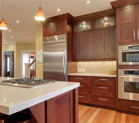 cherry wood cabinets with stainless and light countertop to build or not to build