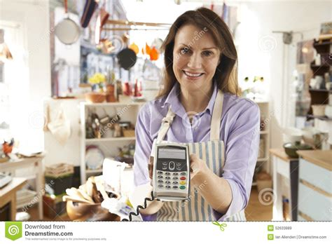 sales assistant in homeware store with credit card machine stock photo image 52633889