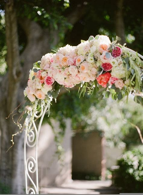 wedding arch flowers arrangements white arch of pastel flowers