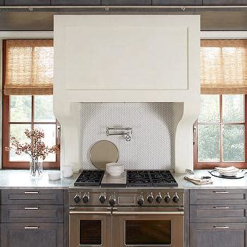 gray distressed kitchen cabinets with marble herringbone grey marble herringbone backsplash transitional kitchen