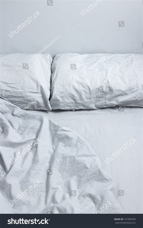 two pillows on bed stock photo image of domestic room messy bed two pillows gray bedclothes stock photo