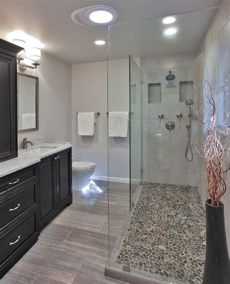 pebble shower floor Bathroom Transitional with bath