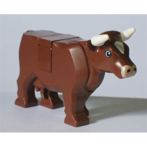 Lego Cow lego cow with white patch on and horns 64452