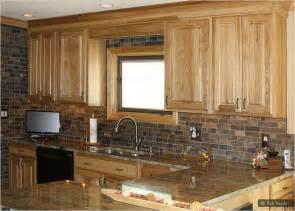 Oak kitchen cabinet granite countertop slate rusty brown backsplash