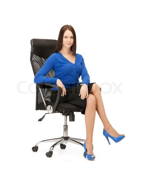 sit in the chair or sit on the chair businesswoman sitting in chair stock photo colourbox