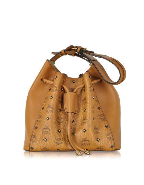 mcm gold visetos cognac medium bag in metallic lyst