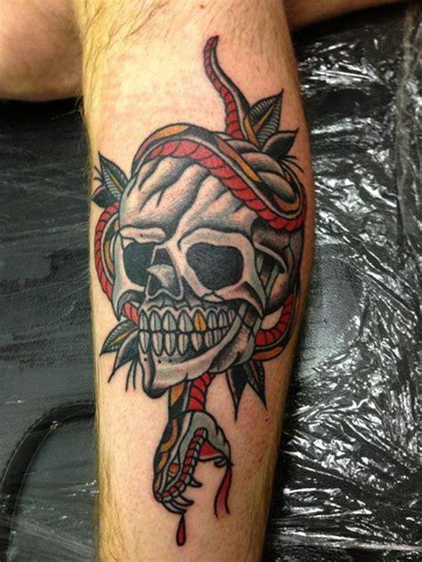 snake tattoo guy london ontario skull and a snake tattoo by hugh sheldon tattoo tattoos