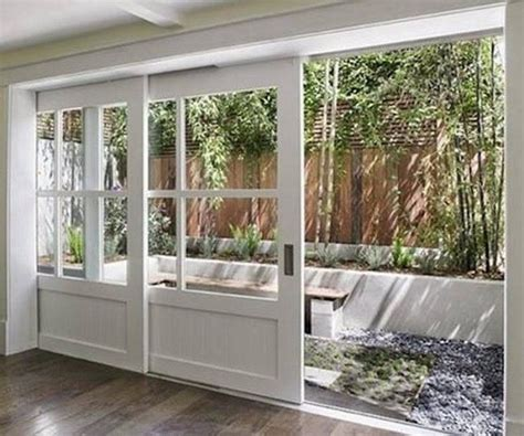 white sliding exterior pocket doors 700x584 jpg 700 215 584