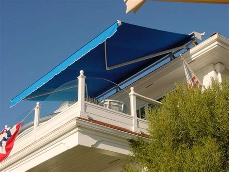 sunset awning custom durasol retractable awning covered in sunbrella