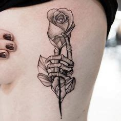 tattoo hand holding rose image result for skeleton hand holding rose tattoo