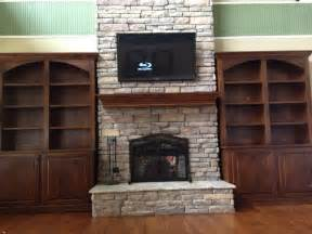 stone around fireplace bookshelves around stone fireplace janice living room