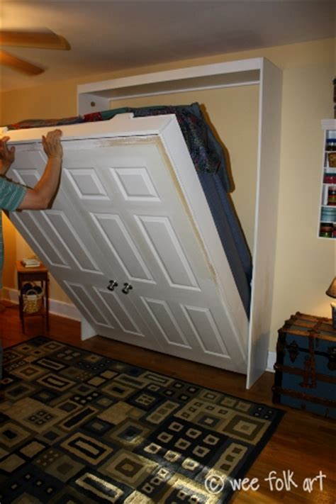 17 best ideas about hide a bed on pinterest murphy bed frame small attic furniture and small beds remodelaholic 100 ways to use old doors