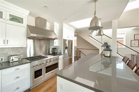 White And Grey Quartz Countertops by West Bay Newport Style Kitchen Orange