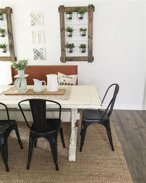white farmhouse table black metal chairs farmhouse
