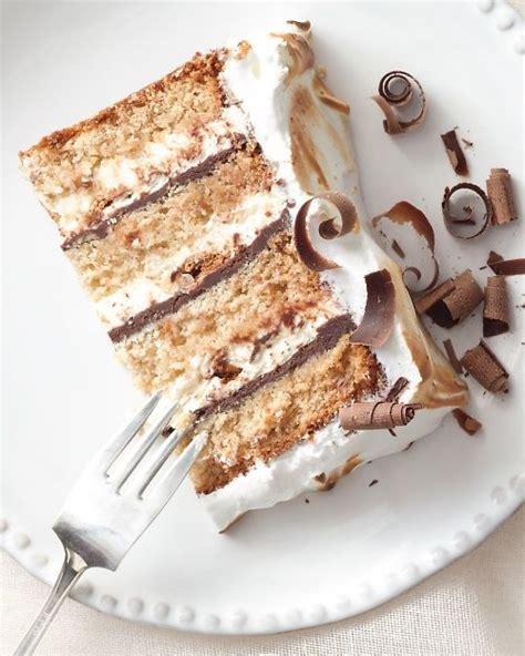 graham cake layers of chocolate ganache whipped cream and marshmallow meringue bakery
