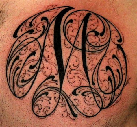 letter m tattoo neotraditional inkanddaggertattoo