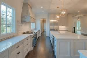 Ordinary Tile Topped Kitchen Tables #4: Half-tiled-kitchen-wall-marble-arabesque-backsplash.jpg