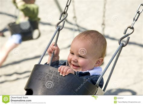 swing for 1 year old cute one year old on swing royalty free stock photography
