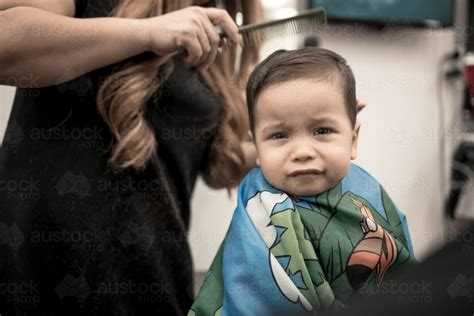 mixed haircut for a mixed one year old boy image of one year old mixed race baby boy has his first