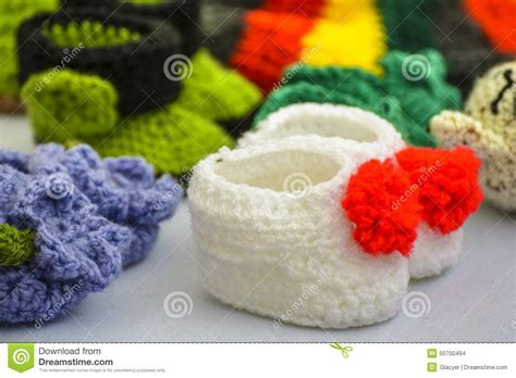 Handmade Baby Booties For Sale - white knitted baby booties stock photo image 50700494