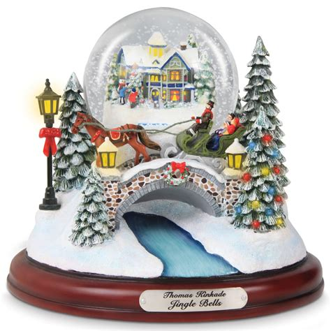 snow globes musical the kinkade musical snowglobe hammacher schlemmer