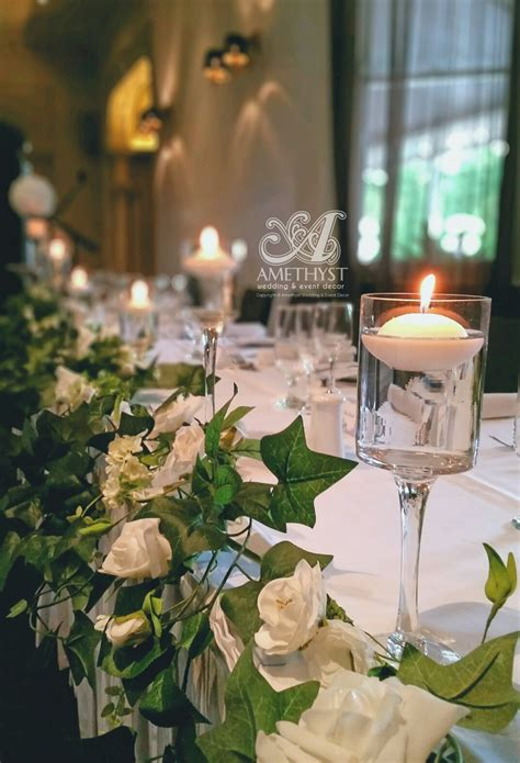 Cylinder Vases With Floating Candles And Flowers by Stem Cylinder Floating Candle Vases Amethyst Wedding