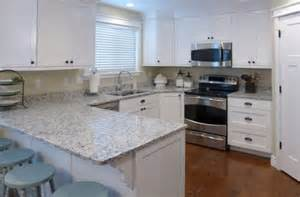 superior What Kind Of Paint To Use On Kitchen Cabinets #9: white-kitchen-cabinets-with-granite-countertops-and-round-backless-bar-stools-on-light-blue-paint-colors-also-3-tier-plate-rack-across-fleur-de-lis-paper-towel-stand-600x395.jpg