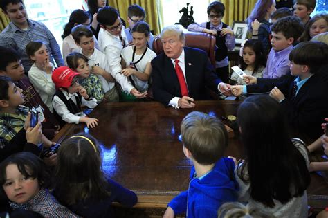 trump hosts white house reporters kids for oval office trump gives oval office tour to white house reporters