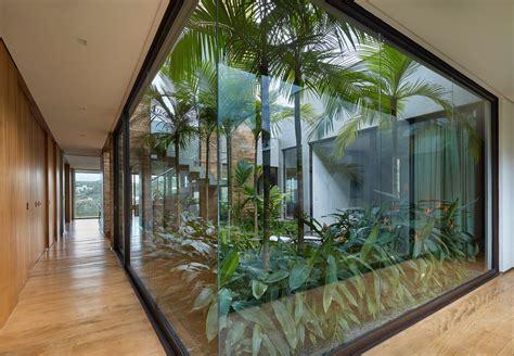 modern house  brazil hides glorious tropical garden curbed