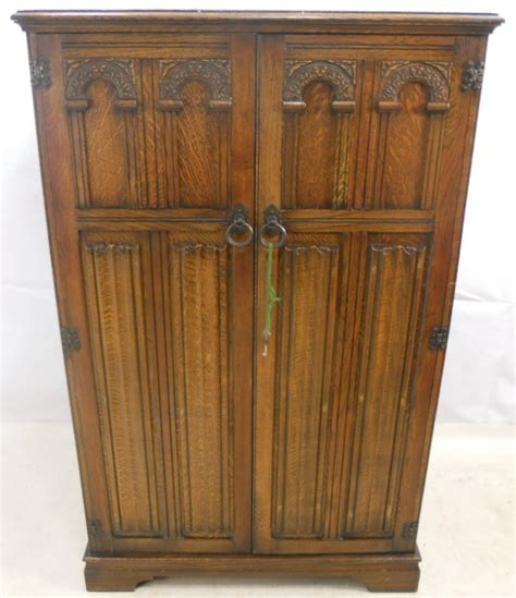 small carved oak two door wardrobe sold