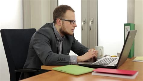 Man Sitting At A Desk Bored Businessman Typing At His Desk Stock Footage