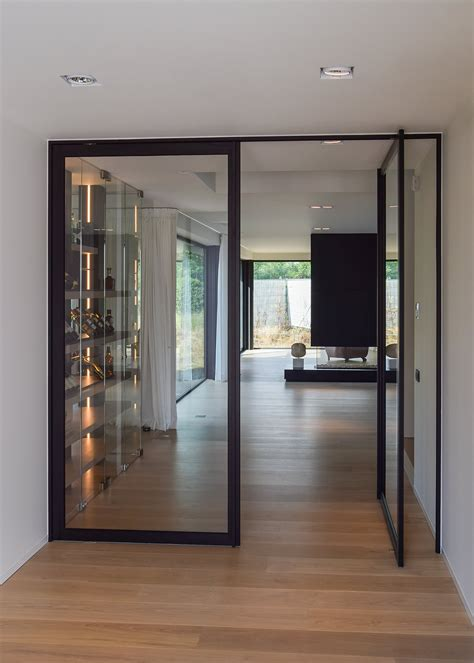 Glass And Steel Doors Modern Glass Pivoting Doors Made To Measure With Innovative Hinges Anyway Doors
